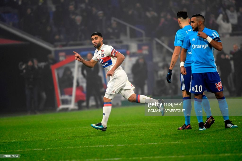Lyon's French forward Nabil Fekir (L) celebrates after scoring a goal during the French L1 football match between Lyon (OL) and Marseille (OM) on December 17, 2017, at the Groupama stadium in Decines-Charpieu near Lyon, central-eastern France. /