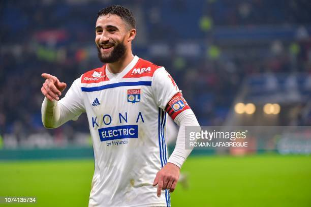 Lyon's French forward Nabil Fekir celebrates after scoring a goal with teammates during the French L1 football match between Lyon and Monaco on...
