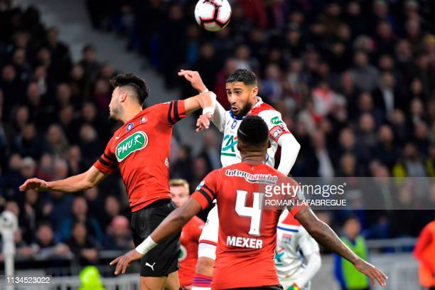 Lyon's French forward Nabil Fekir heads the ball with Rennes' Algerian defender Ramy Bensebaini during the French Cup semifinal football match...
