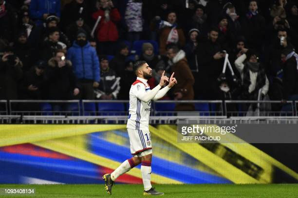 Lyon's French forward Nabil Fekir jubilates after scoring a goal during the French L1 football match between Olympique Lyonnais and ParisSaint...