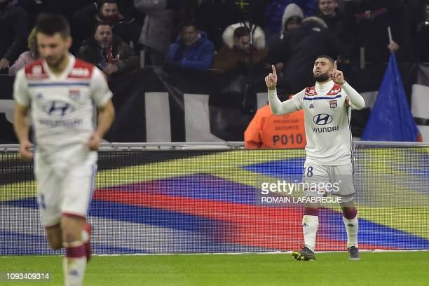 Lyon's French forward Nabil Fekir jubilates after scoring a goal during the French L1 football match between Olympique Lyonnais and Paris-Saint...