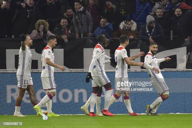 Lyon's French forward Nabil Fekir jubilates with teammates after scoring a goal during the French L1 football match between Olympique Lyonnais and...