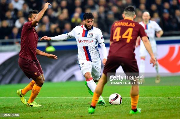 Lyon's French forward Nabil Fekir kicks the ball and scores during the Europa League round of 16 first leg football match between Lyon and AS Roma on...