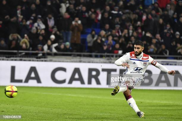 Lyon's French forward Nabil Fekir shoots a penalty prior to score a goal during the French L1 football match between Olympique Lyonnais and...