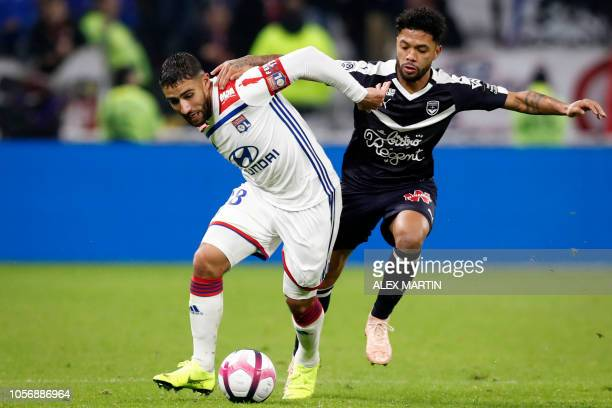 TOPSHOT Lyon's French forward Nabil Fekir vies with Bordeaux's Brazilian midfielder Otavio during the French L1 football match between Olympique...