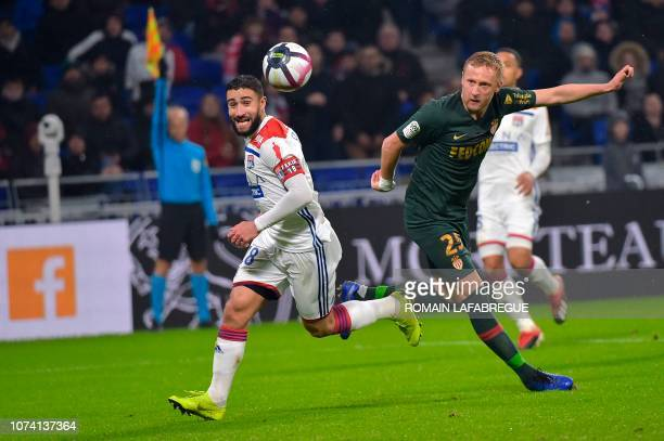 Lyon's French forward Nabil Fekir vies with Monaco's Polish defender Kamil Glik during the French L1 football match between Lyon and Monaco on...