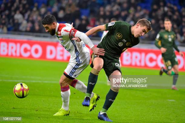 Lyon's French forward Nabil Fekir vies with Reims' Belgian midfielder Bjorn Engels during the French L1 football match between Lyon and Reims on...