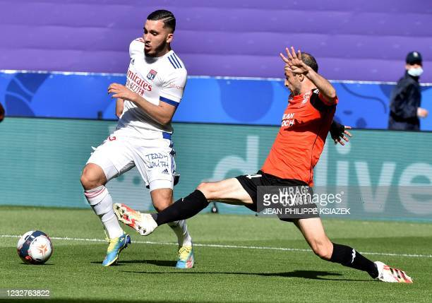 Lyon's French forward Rayan Cherki fights for the ball with Lorient's French defender Jerome Hergault during the French L1 football match between...