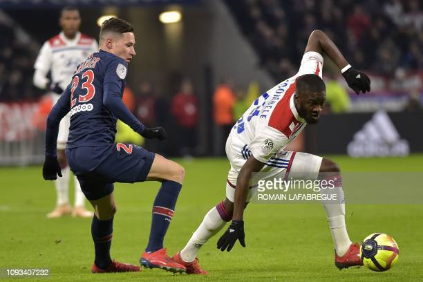 Lyon's French forward Tanguy NDombele fights for the ball with Paris SaintGermain's German midfielder Julian Draxler during the French L1 football...