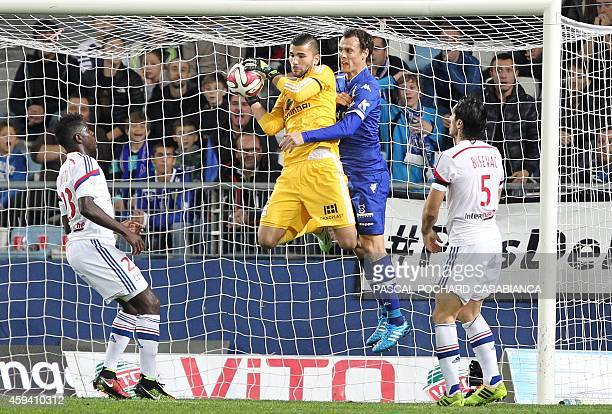 Lyon's French goalkeeper Anthony Lopes vies with Bastia's French defender Sebastien Squillaci during the French L1 football match Bastia against Lyon...