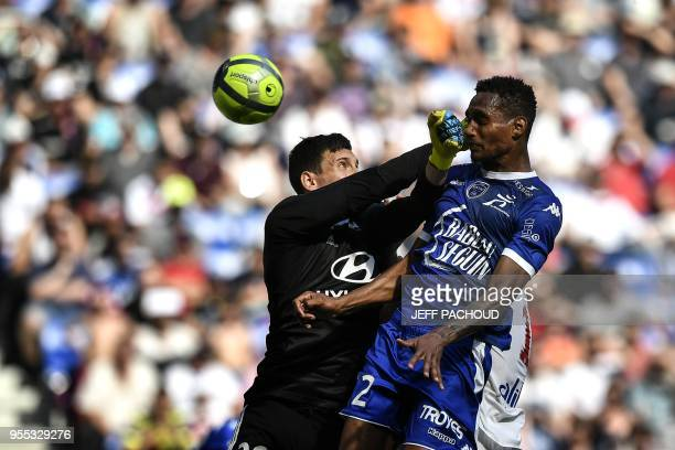 TOPSHOT Lyon's French goalkeeper Mathieu Gorgelin vies with Troyes' French defender Christophe Herelle during the French L1 football match Olympique...