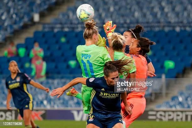 Lyon's French goalkeeper Sarah Bouhaddi collides with VfL Wolfsburg's Swedish midfielder Fridolina Rolfo during the UEFA Women's Champions League...