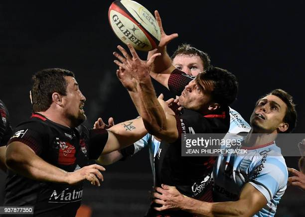 Lyon's French hooker Mickael Ivaldi and Lyon's French fly-half Lionel Beauxis vies with Racing 92's Argentinian winger Juan Imhoff during the French...
