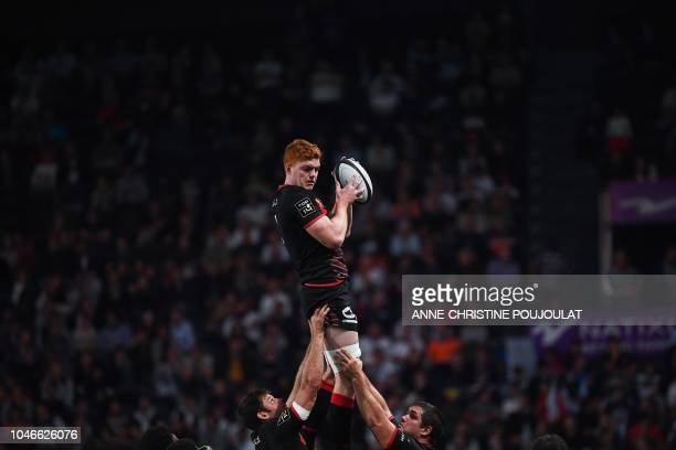 TOPSHOT Lyon's French lock Felix Lambey jumps fort the ball during the French Top 14 rugby union match between Racing92 and Lyon on October 6 2018 at...