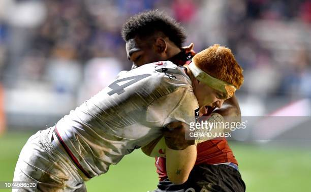 Lyon's French lock Felix Lambey vies with Toulon's Fiji wing Filipo Nakosi during the French Top 14 rugby union match between Toulon and Lyon on...