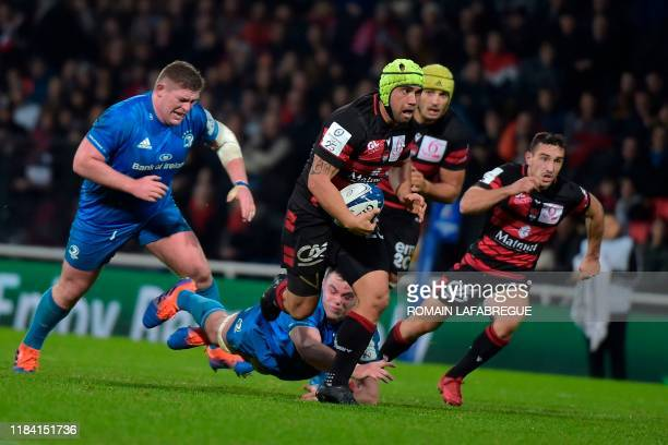 Lyon's French lock Virgile Bruni runs with the ball during the European Champions Cup rugby union match between Lyon and Leinster at the Matmut...