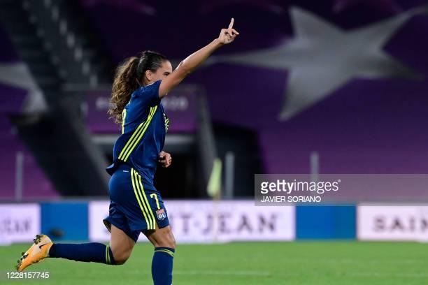 Lyon's French midfielder Amel Majri celebrates after scoring a goal during the UEFA Women's Champions League quarter-final football match between...