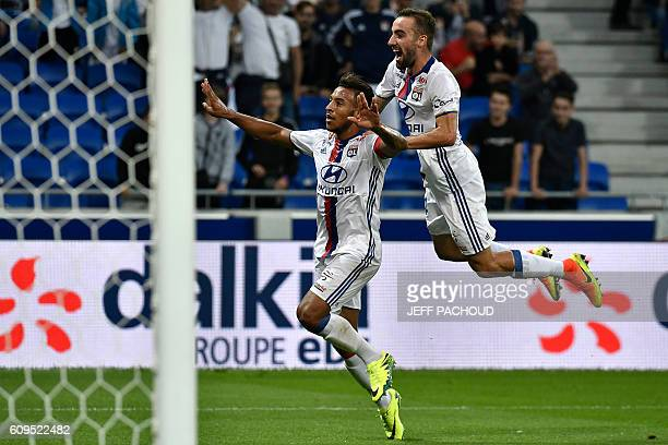 Lyon's French midfielder Corentin Tolisso celebrates after scoring a goal during the French L1 football match between Olympique Lyonnais and...