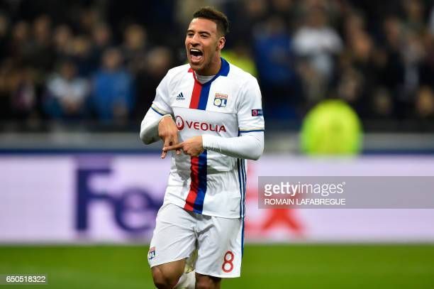 Lyon's French midfielder Corentin Tolisso celebrates after scoring a goal during the UEFA Europa League round of 16 football match between Lyon and...