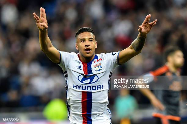 Lyon's French midfielder Corentin Tolisso celebrates after scoring a goal during the French L1 football match between Olympique Lyonnais and Lorient...