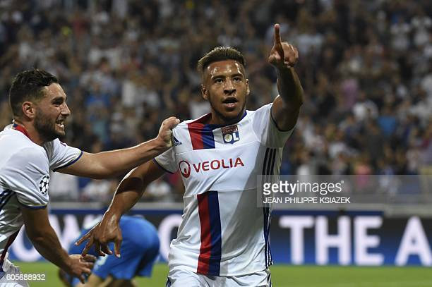 Lyon's French midfielder Corentin Tolisso celebrates after scoring during the Champions League Group H football match between Olympique Lyonnais and...