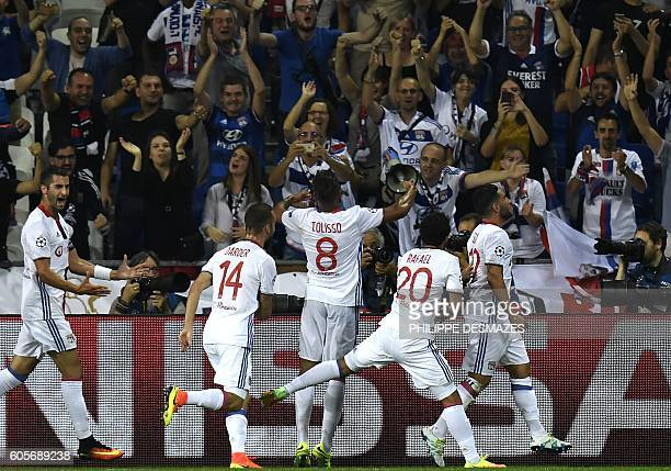 Lyon's French midfielder Corentin Tolisso celebrates with fans after scoring during the Champions League Group H football match between Olympique...