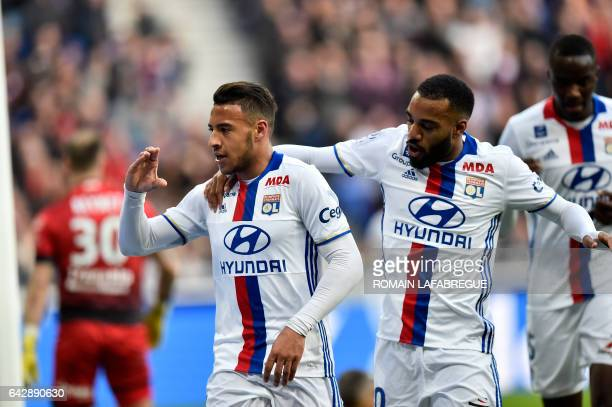 Lyon's French midfielder Corentin Tolisso celebrates with Lyon's French forward Alexandre Lacazette after scoring a goal during the French L1...