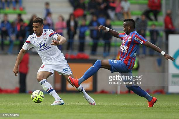 Lyon's French midfielder Corentin Tolisso fights for the ball with Caen's French forward Lenny Nangis during the French L1 football match between...
