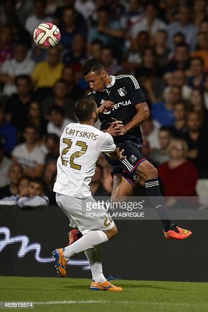 Lyon's French midfielder Corentin Tolisso vies for the ball with Giurgiu's Greek defender Vasileios Pliatsikas during the UEFA Europa League football...