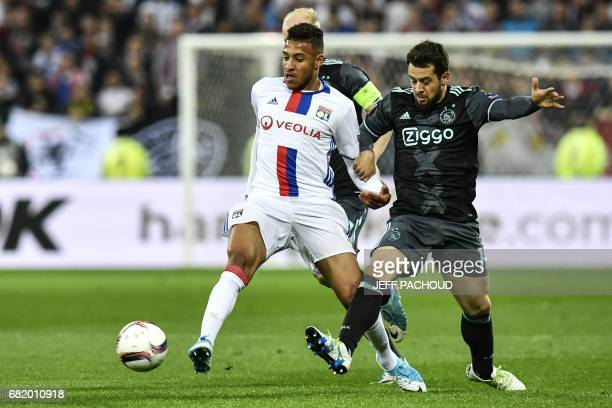Lyon's French midfielder Corentin Tolisso vies with Ajax' German forward Amin Younes during the Europa League semi final football match Olympique...