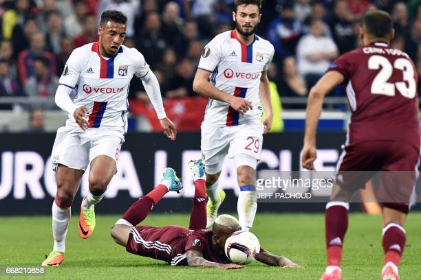 Lyon's French midfielder Corentin Tolisso vies with Besiktas' Brazilian midfielder Anderson Talisca during the UEFA Europa League first leg quarter...