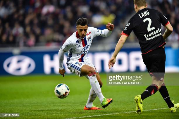 Lyon's French midfielder Corentin Tolisso vies with Dijon's Hongarian defender Adam Lang during the French L1 football match between Olympique...