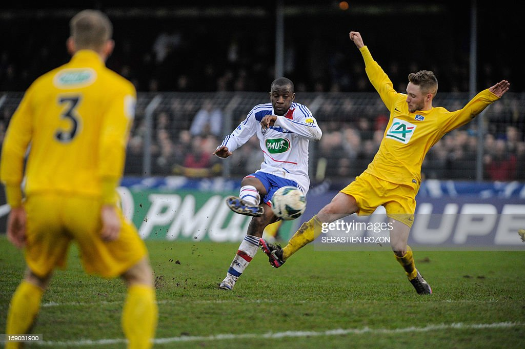 Lyon's French midfielder Gueida Fofana (C) vies with Epinal's French defender Victor di Pinto (R) during the French cup football match Epinal (SAS) versus Lyon (OL) at the Colombiere Stadium in Epinal, on January 6, 2013.