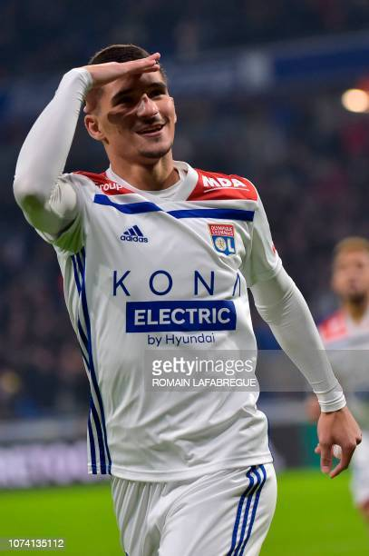 Lyon's French midfielder Houssem Aouar celebrates after scoring a goal during the French L1 football match between Lyon and Monaco on December 16 at...