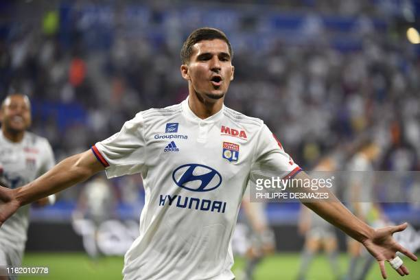 Lyon's French midfielder Houssem Aouar celebrates after scoring a goal during the French L1 football match between Olympique Lyonnais and Angers SCO...