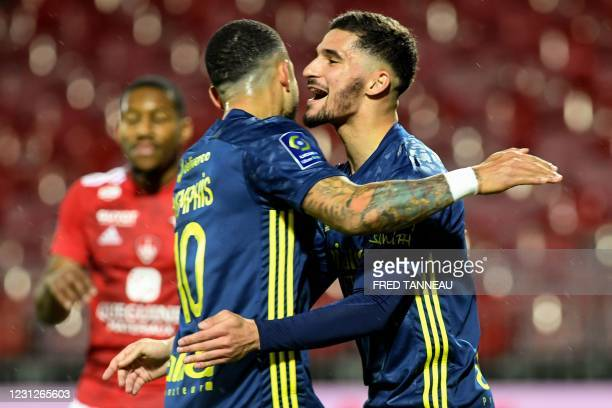 Lyon's French midfielder Houssem Aouar celebrates after scoring a goal during the French L1 football match between Stade Brestois 29 and Olympique...