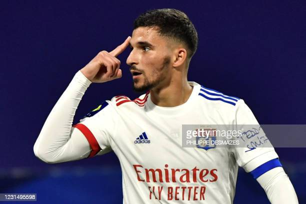 Lyon's French midfielder Houssem Aouar celebrates after scoring during the French L1 football match between Olympique Lyonnais and Stade Rennais...