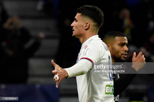 Lyon's French midfielder Houssem Aouar celebrates after scoring their second goal during the French League Cup quarterfinal football match between...