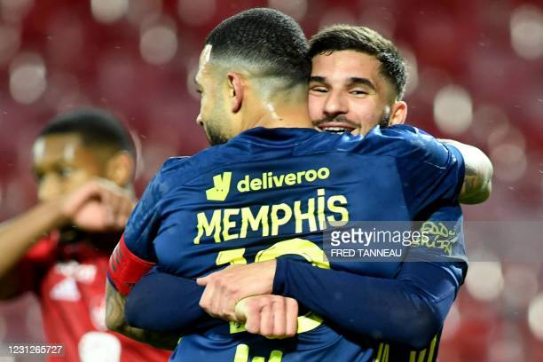 Lyon's French midfielder Houssem Aouar celebrates with teammate Lyon's Dutch forward Memphis Depay after scoring a goal during the French L1 football...