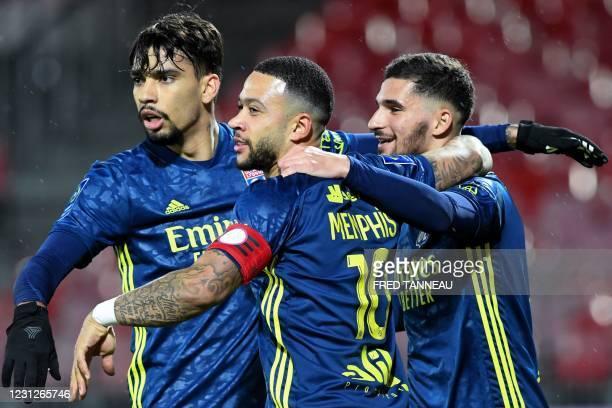 Lyon's French midfielder Houssem Aouar celebrates with teammates Lyon's Dutch forward Memphis Depay and Lyon's Brazilian midfielder Lucas Paqueta...