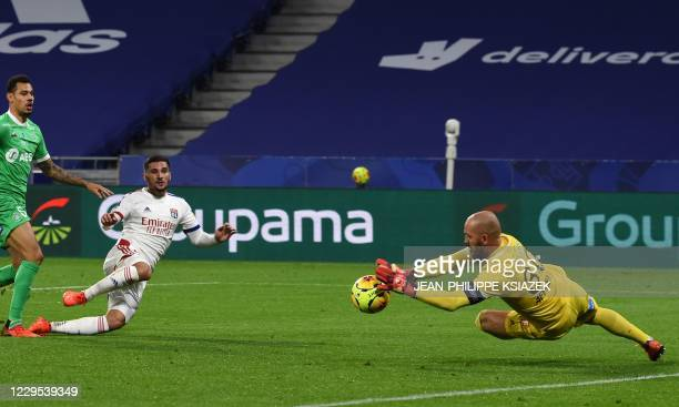 Lyon's French midfielder Houssem Aouar fights for the ball with SaintEtienne's French goalkeeper Jessy Moulin during the French L1 football match...