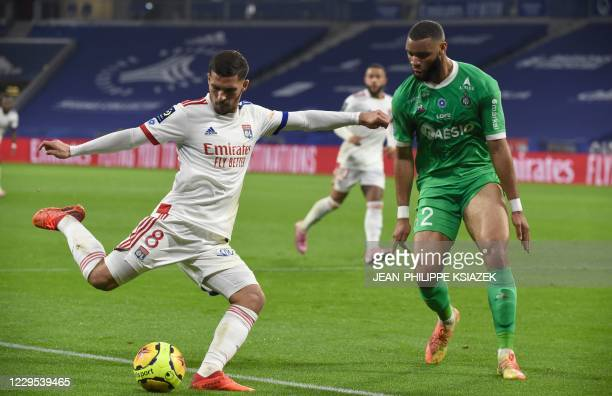 Lyon's French midfielder Houssem Aouar fights for the ball with SaintEtienne's Camerounian defender Harold Moukoudi during the French L1 football...
