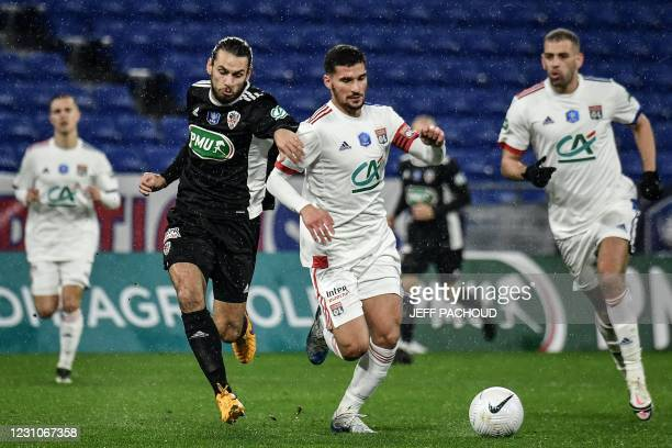 Lyon's French midfielder Houssem Aouar fights for the ball with Ajaccio's French midfielder Vincent Marchetti during the French Cup football match,...