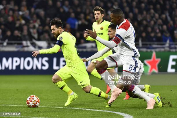 Lyon's French midfielder Houssem Aouar makes a fault on Barcelona's Argentinian forward Lionel Messi outside the penalty area next to Lyon's...