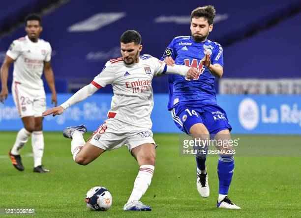 Lyon's French midfielder Houssem Aouar shoots past Strasbourg's Bosnian midfielder Sanjin Prcic during the French L1 football match between Olympique...