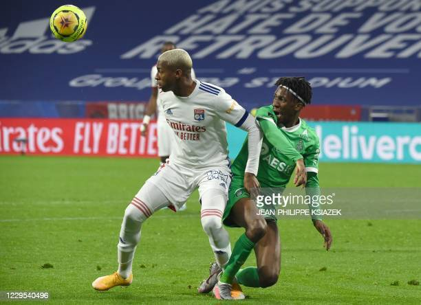 Lyon's French midfielder Jean Lucas De Souza Olivera fights for the ball with SaintEtienne's Camerounian midfielder Yvan Neyou during the French L1...