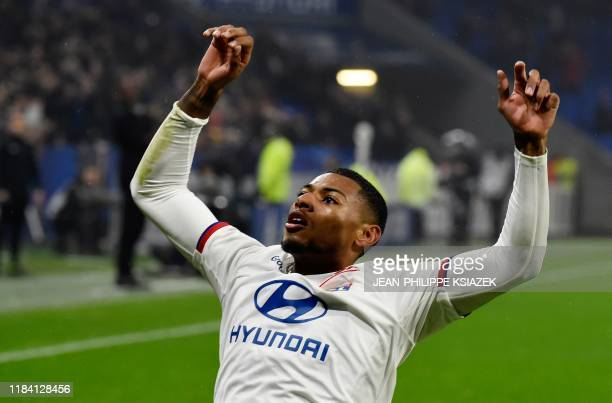 Lyon's French midfielder Jeff Reine-Adelaide celebrates after scoring a goal during the French L1 football match between Lyon and Nice on November 23...