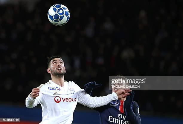 Lyon's French midfielder Jordan Ferri heads the ball nex to Paris SaintGermain's Italian midfielder Marco Verratti during the French League Cup...