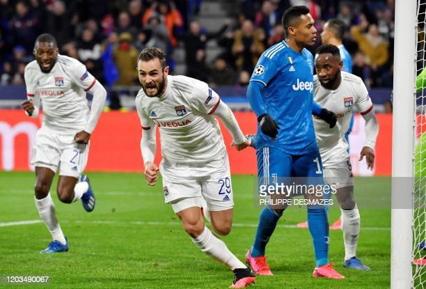 Lyon's French midfielder Lucas Tousart celebrates after scoring a goal during the UEFA Champions League round of 16 first-leg football match between...