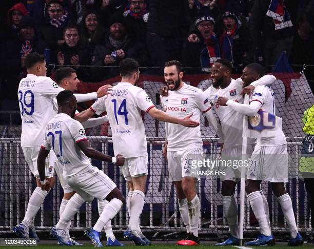 Lyon's French midfielder Lucas Tousart celebrates with teammates after scoring a goal Decines-Charpieu, central-eastern France, on February 26, 2020.